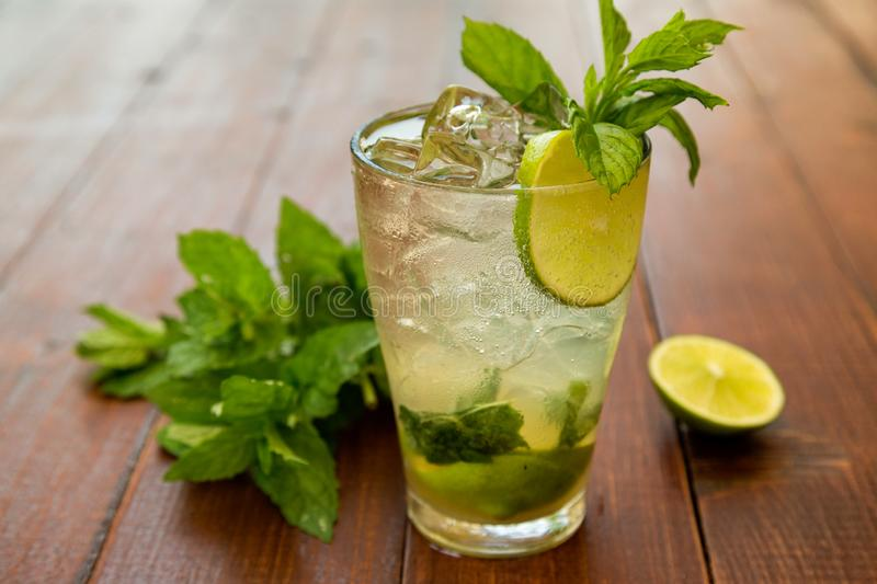 Mojito. Cocktail with white rum, ice cubes, sugar, limes and mint leaves stock photo