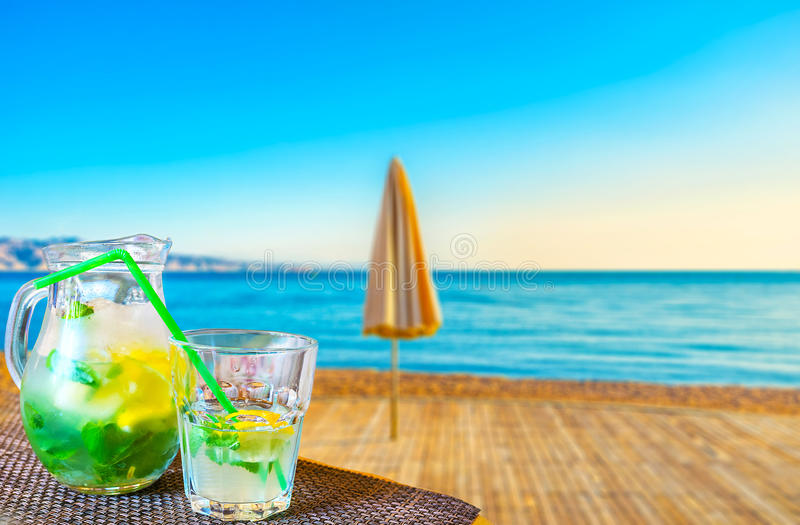 Mojito on Eilat beach. The best way to relax, watching the beach on Red sea, is to drink a glass of fresh mojito in coastal bar of Eilat, Israel royalty free stock photography