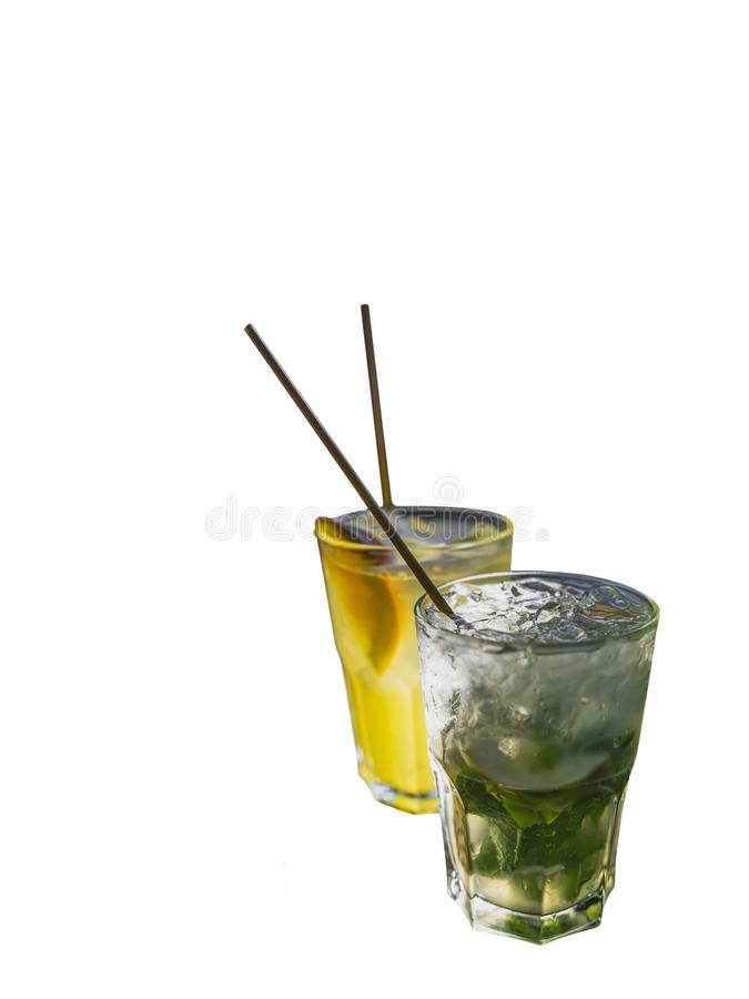 Mojito with ice in weeping glass with eco-friendly bamboo straw and fruit cocktail with orange slice and eco small tube are royalty free stock photo