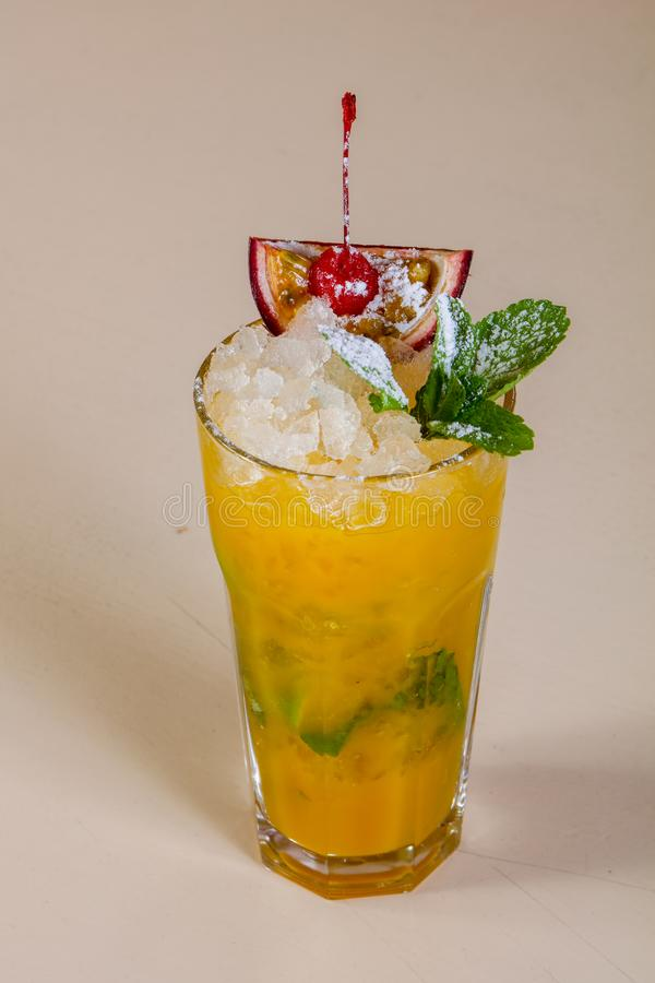 Mojito with passion fruit. And mint stock photos