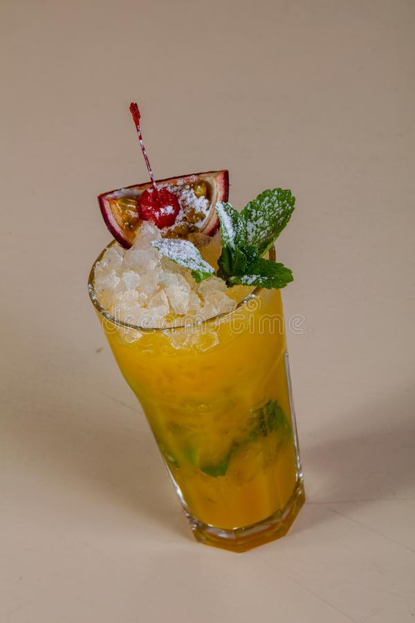 Mojito with passion fruit. And mint stock photography