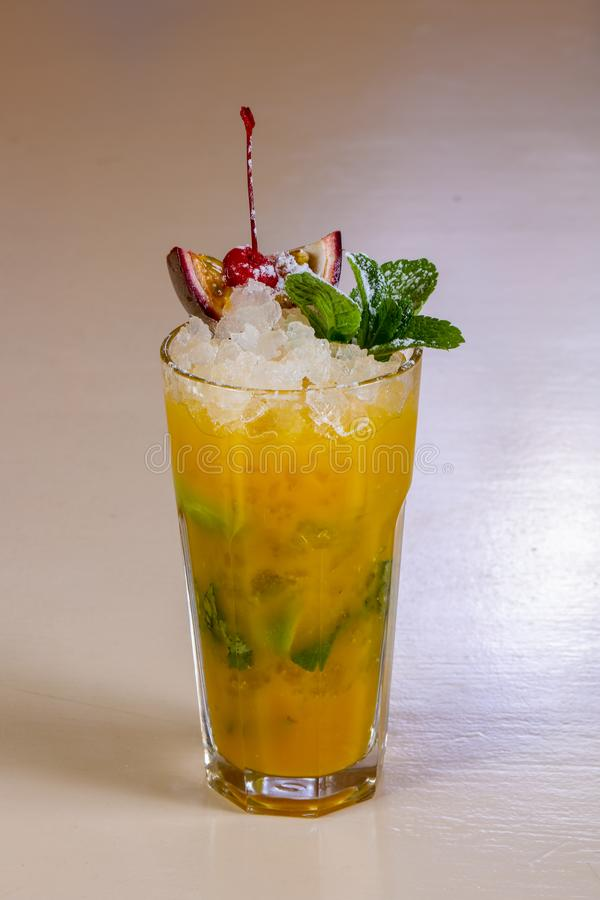 Mojito with passion fruit. And mint stock images