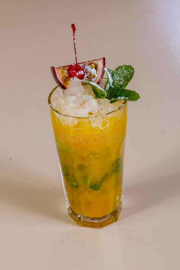 Mojito with passion fruit. And mint royalty free stock photography