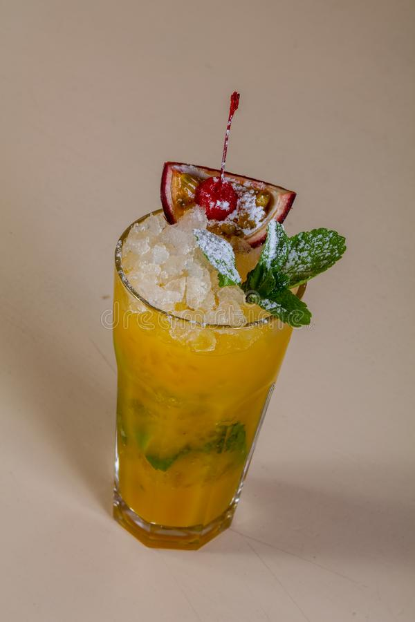 Mojito with passion fruit. And mint royalty free stock image