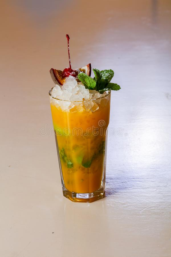 Mojito with passion fruit. And mint royalty free stock photo