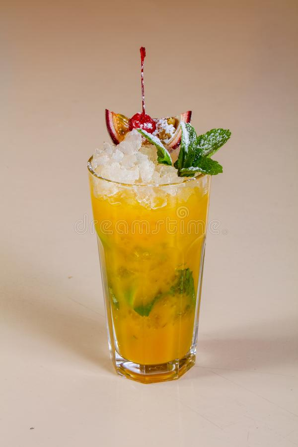Mojito with passion fruit. And mint royalty free stock photos
