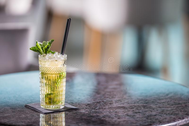 Mojito summer alcoholic cocktail on table in restaurant.  stock photography