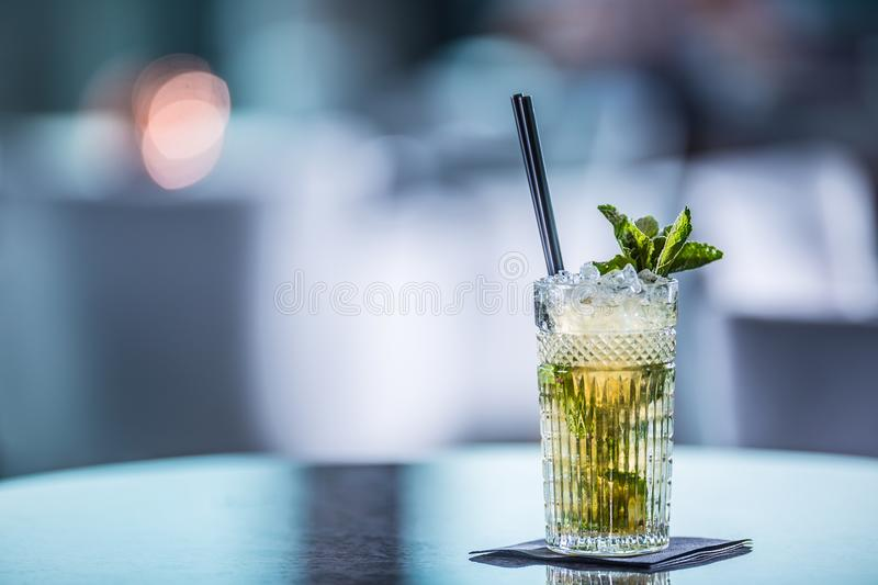 Mojito summer alcoholic cocktail on table in restaurant royalty free stock photos