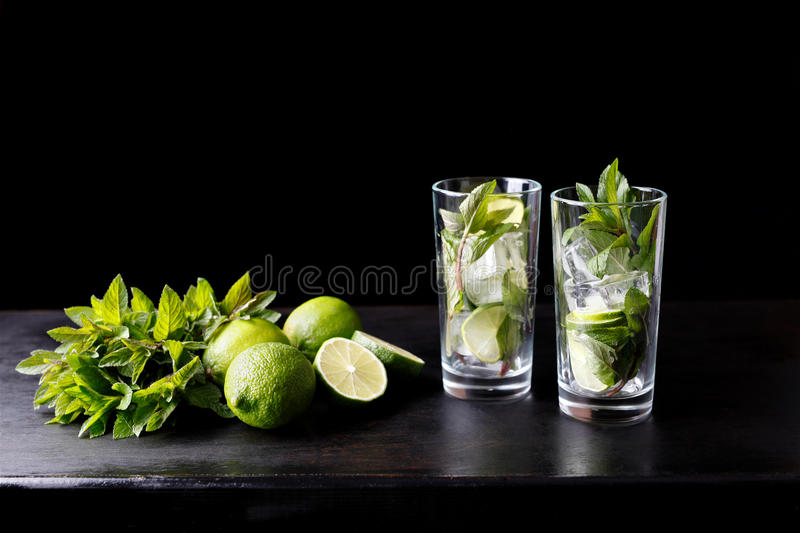 Mojito traditional refreshing cocktail alcohol drink in glass bar preparation stock image