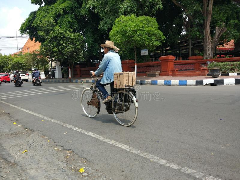 TRANSPORTATION. Mojokerto/Indonesia 11032019: Old man riding an old bicycle on the street on November 03,2019 in mojokerto, Indonesia royalty free stock image