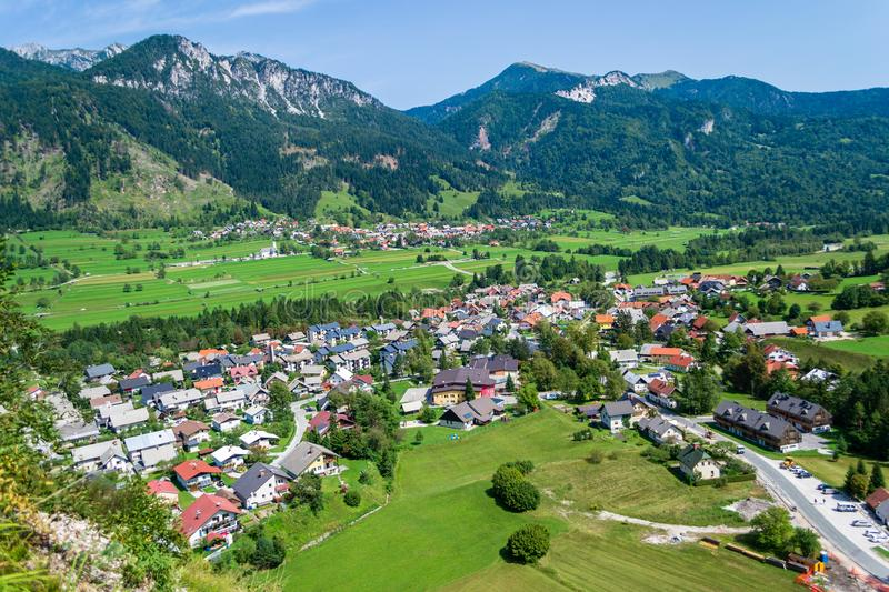 Mojstrana village in Slovenia - aerial view on a bright, sunny day, with Karawanks mountain range visible in the back. Tourism concept for outdoor enthusiasts stock image