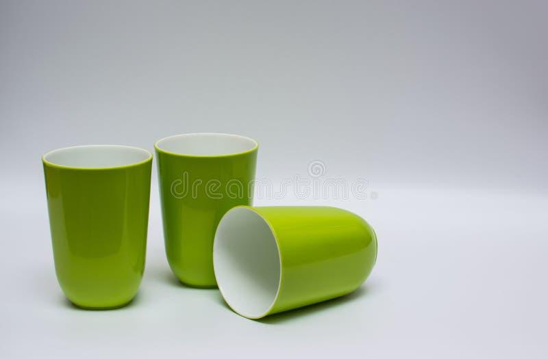 Mok drie plastiek stock afbeelding
