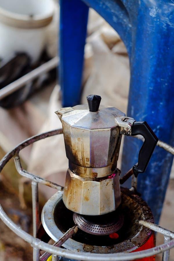 Moka coffee maker pot on stove. Moka coffee maker pot on gas stove royalty free stock photos