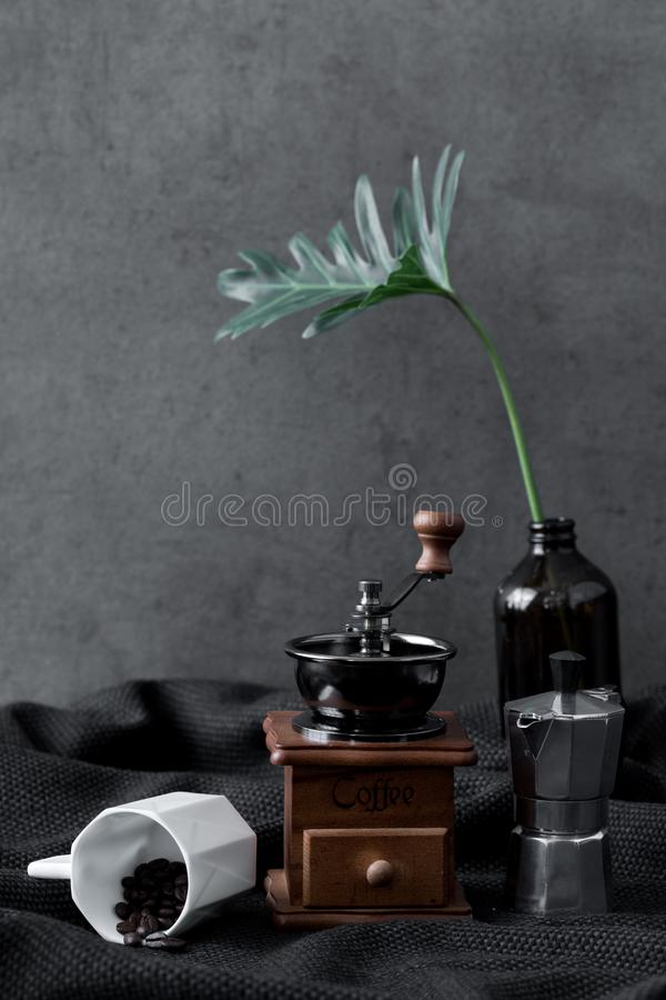 Moka pot coffee and grinder mill espresso maker vintage machine. Style with black background stock images
