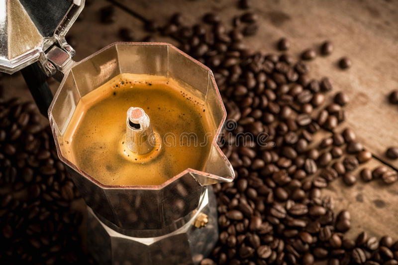 Moka pot old coffee maker and coffee beans. Espresso in Moka pot old coffee maker and coffee beans stock images