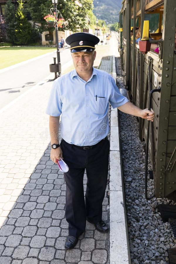 Free Mokra Gora, Serbia, July 17 2017: Train Driver Is Waiting For A Train Car On The Departure Signal Of The Locomotive Driver. Stock Image - 114845991