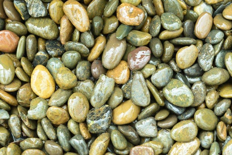 Mokry round kamienia tło fotografia stock