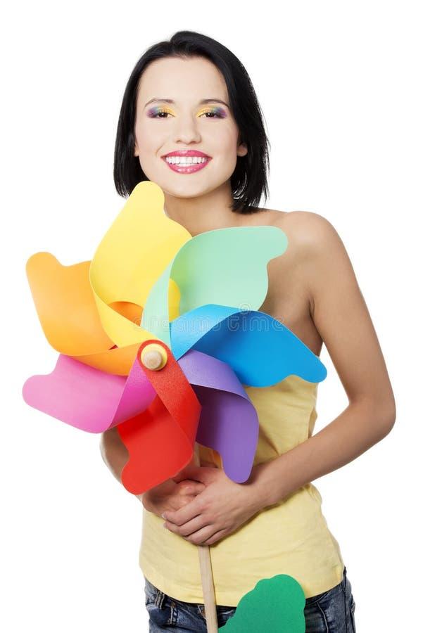 Download Mola/menina Do Verão Com O Brinquedo Do Moinho De Vento Da Cor Foto de Stock - Imagem de ecology, cosméticos: 29827394
