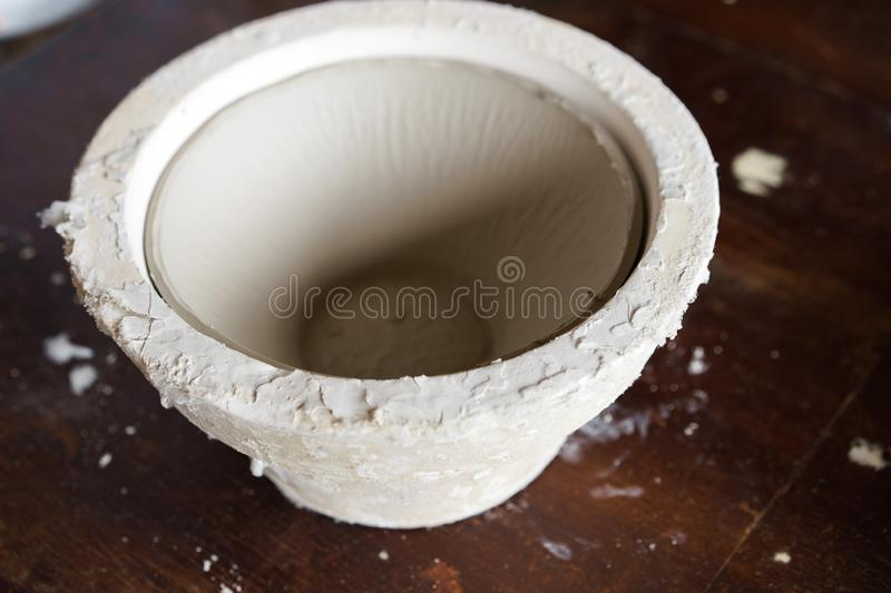 Mold for casting clay products with a finished bowl inside stock photography