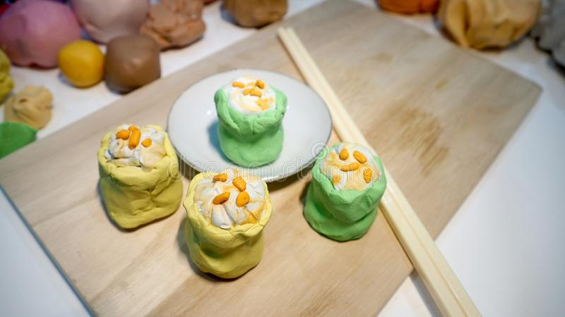 Mold clay create art activity of food is dim sum or Chinese Steamed Dumpling shrimp yellow and green. Mold clay create art activity of food is Chinese Steamed stock photo