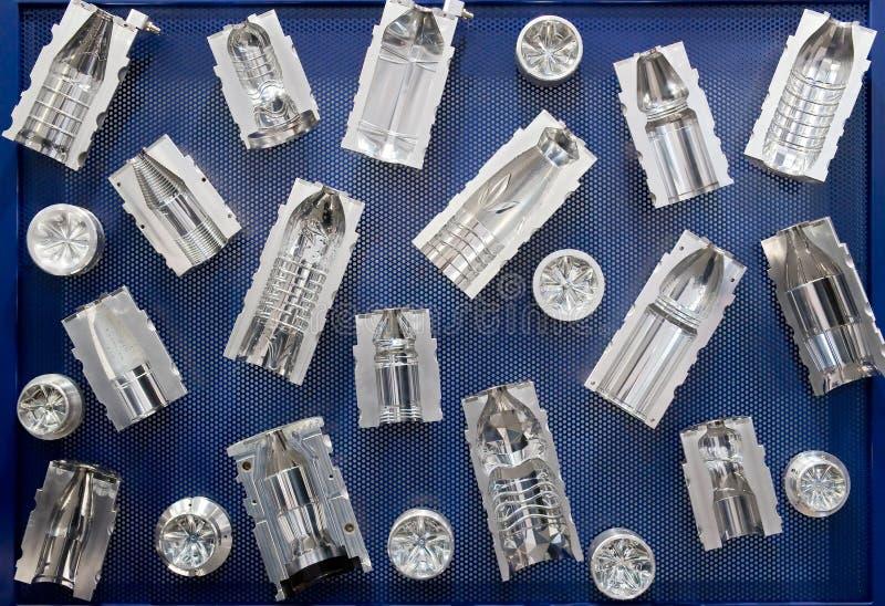 Moldes para las botellas plásticas fotos de archivo libres de regalías