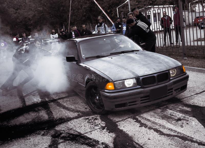 Moldova 25.09.2019. Sport modern Stance E36 BMW Car racing car drifting with smoke drift burnout, Huge clouds with. Moldova 25.09.2019. Sport modern Stance E36 stock photos