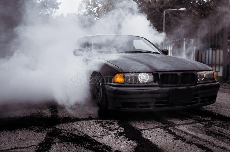 Moldova 25.09.2019. Sport modern Stance E36 BMW Car racing car drifting with smoke drift burnout, Huge clouds with. Moldova 25.09.2019. Sport modern Stance E36 stock images