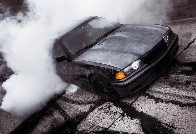 Moldova 25.09.2019. Sport modern Stance E36 BMW Car racing car drifting with smoke drift burnout, Huge clouds with. Moldova 25.09.2019. Sport modern Stance E36 royalty free stock photography