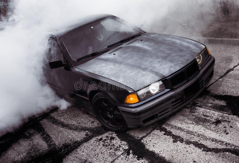 Moldova 25.09.2019. Sport modern Stance E36 BMW Car racing car drifting with smoke drift burnout, Huge clouds with. Moldova 25.09.2019. Sport modern Stance E36 royalty free stock photos