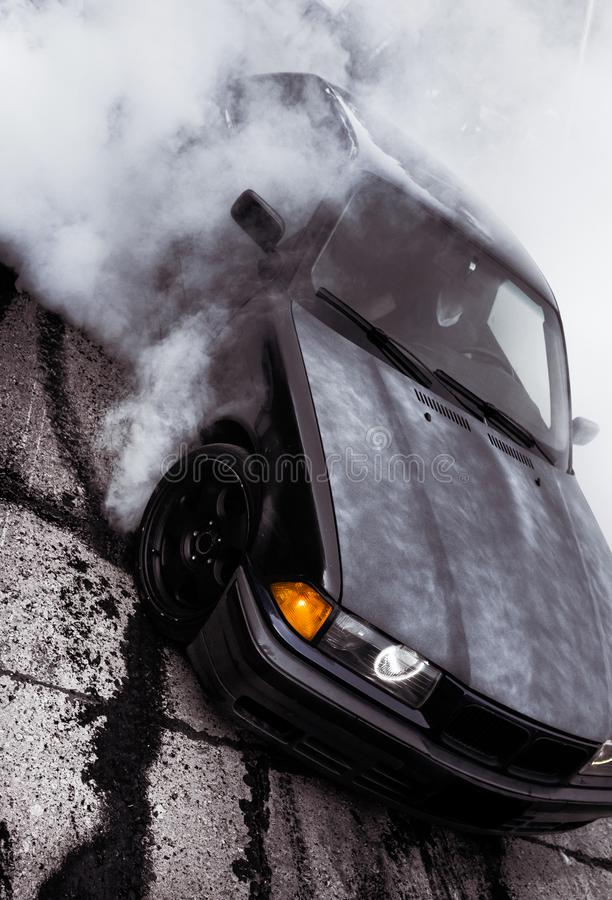 Moldova 25.09.2019. Sport modern Stance E36 BMW Car racing car drifting with smoke drift burnout, Huge clouds with stock image