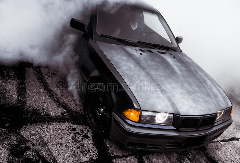 Moldova 25.09.2019. Sport modern Stance E36 BMW Car racing car drifting with smoke drift burnout, Huge clouds with royalty free stock photography