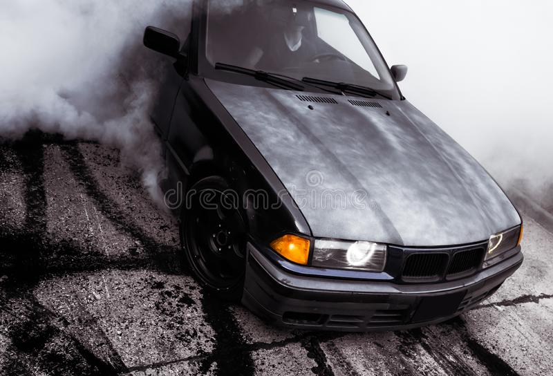 Moldova 25.09.2019. Sport modern Stance E36 BMW Car racing car drifting with smoke drift burnout, Huge clouds with stock images