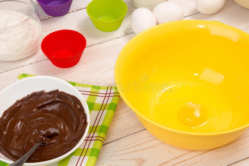 Molds and ingredient for baking cupcake and muffins stock photography