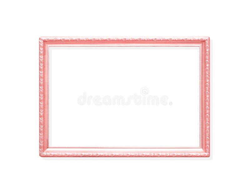 Moldura para retrato cor-de-rosa do metal colorido da decoração com cinzeladura dos testes padrões de flor isolados no fundo bran fotos de stock
