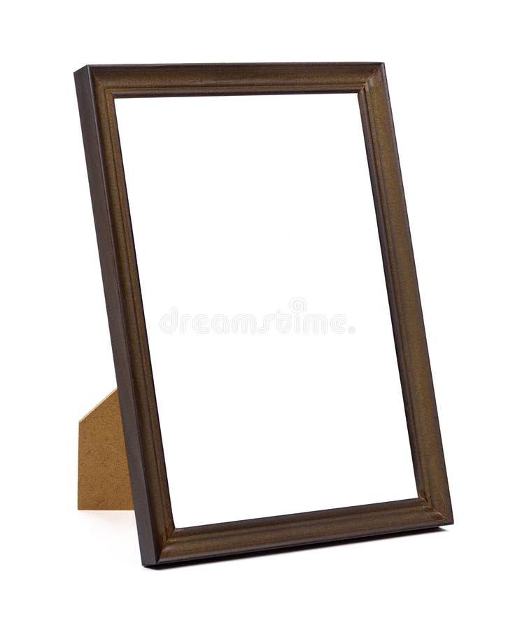 Moldura para retrato de madeira de Brown no fundo branco fotografia de stock