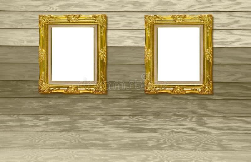 Moldura para retrato dourada antiga de Twain na textura de madeira foto de stock
