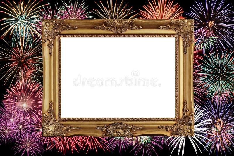 A moldura para retrato dourada com comemora o fundo do fogo de artifício fotografia de stock