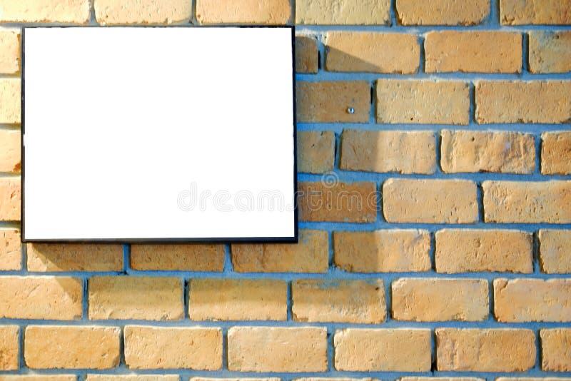Moldura para retrato na parede de tijolo vermelho fotografia de stock