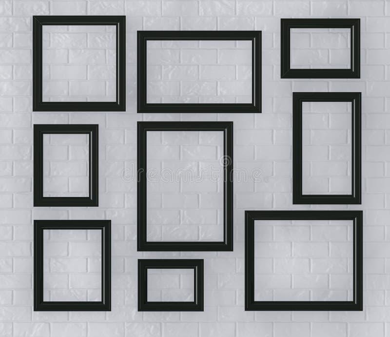 Molduras para retrato pretas em uma parede de tijolo imagem de stock royalty free