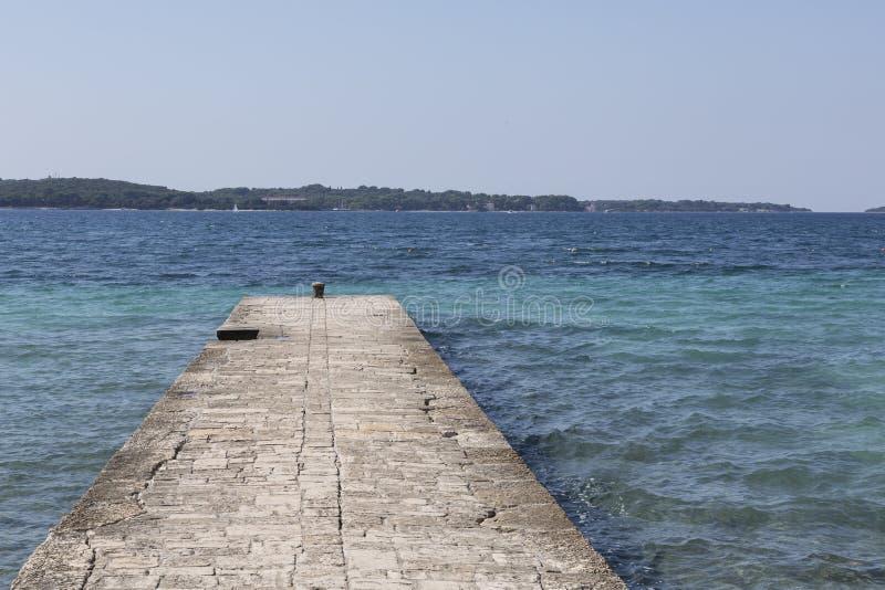 Mole at the Adriatic sea. Mole at the beach in Adriatic sea in Istria northern part of Croatia. In the beach town Fazana royalty free stock photo