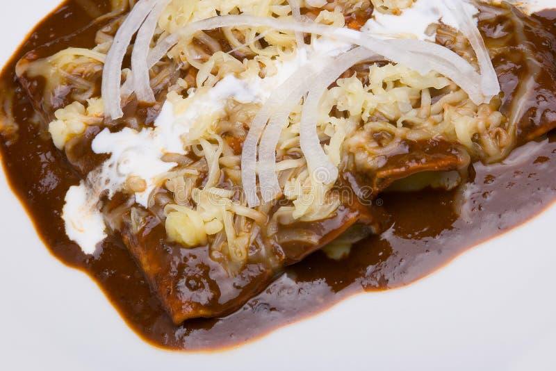 Mole enchiladas close-up stock photos