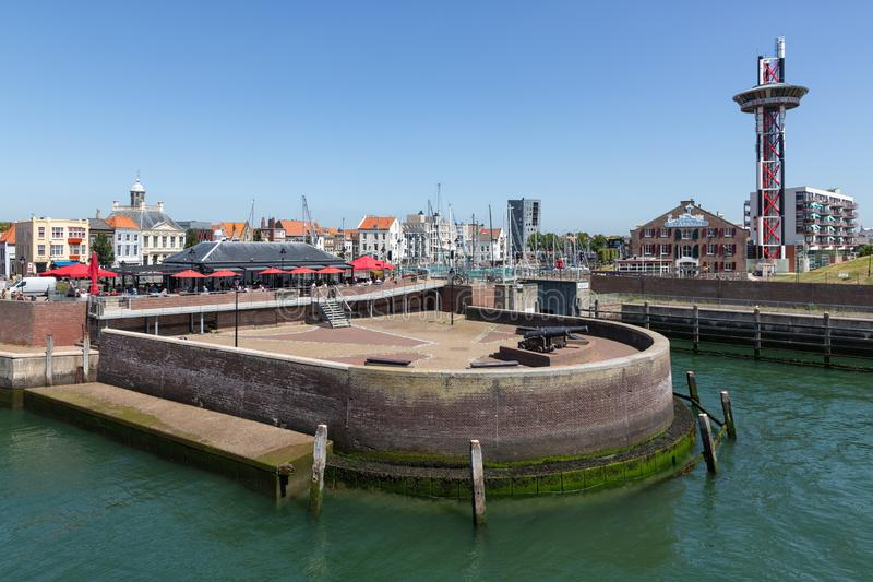 Mole in historic harbor Dutch Vlissingen with restaurant and terrace royalty free stock photos