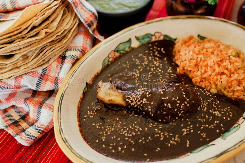 Mole Poblano Traditional Mexican Food with Chicken in Mexico. Mexican Feast in a talavera plate stock photo