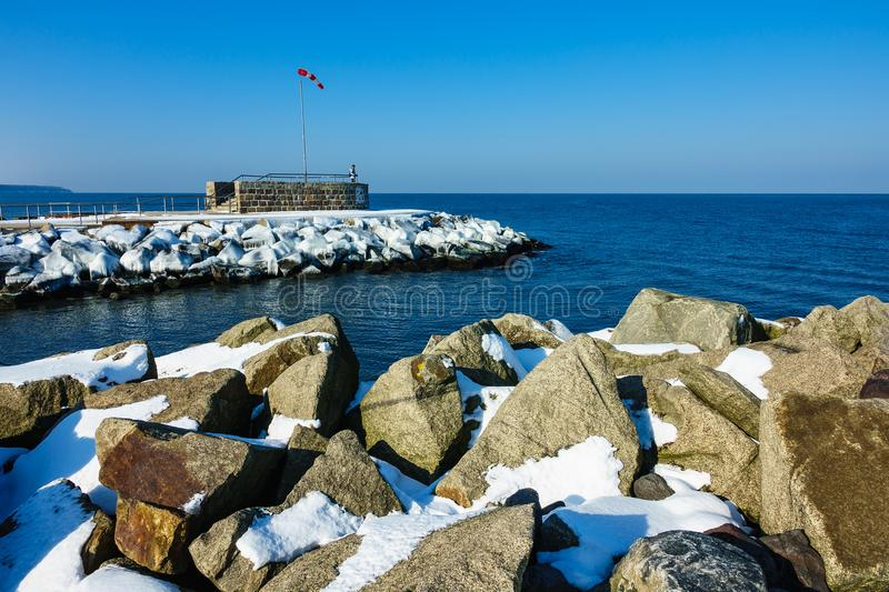 Mole in winter time in Warnemuende, Germany royalty free stock photos
