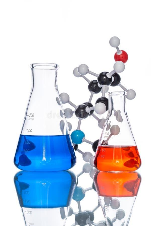 Moleculaire Structuur en kleurrijke vloeistof stock afbeelding