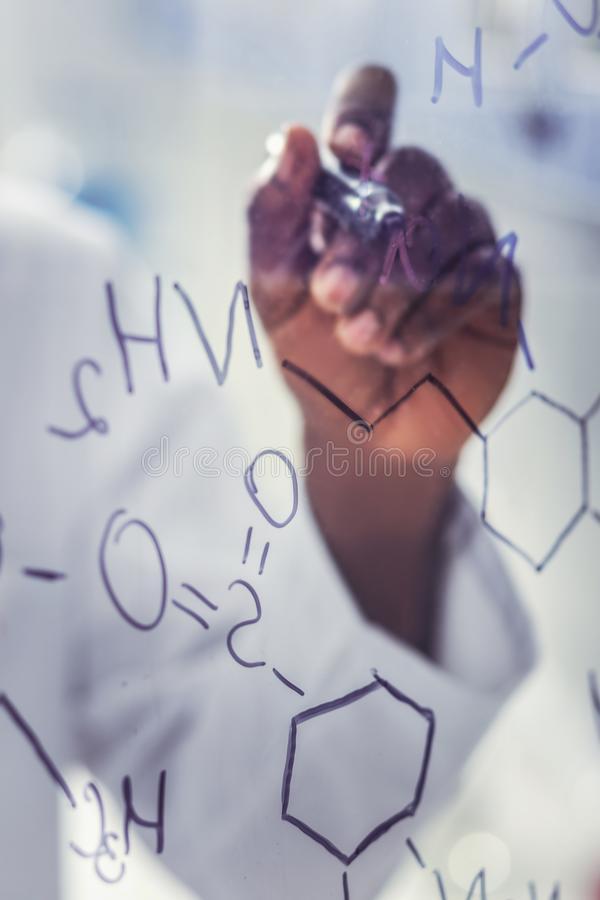 Molecular chain being on glass board in laboratory. Molecular chain. Long molecular chain being on glass board in modern chemical laboratory stock photos