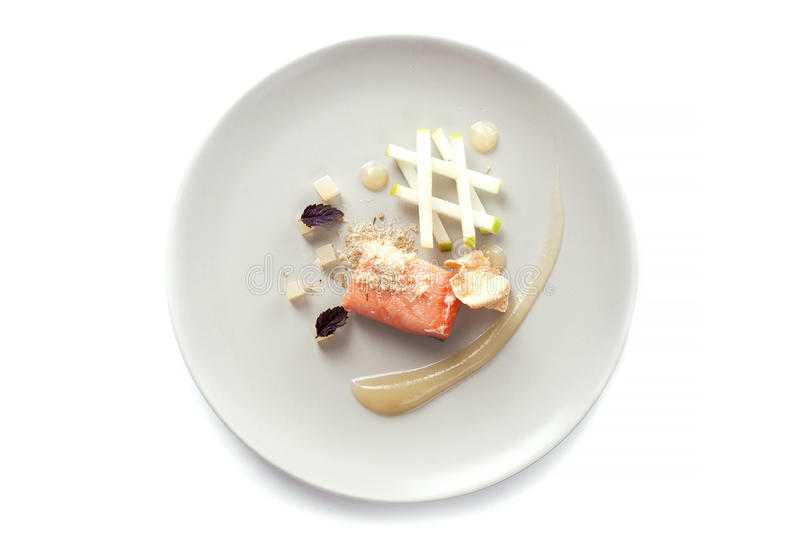 Molecular modern cuisine red fish. In a dish with beautiful garnish close up. Isolated stock photos