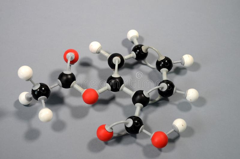 Molecule model of acetylsalicylic acid HC9H7O4. ASA. Red is oxygen, black is carbon, and white is hydrogen royalty free stock images