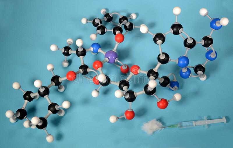 Molecule model of the antiviral preparate remdesivir that may be able to calm the symptoms of Covid 19 virus. White is Hydrogen, black is Carbon, blue is stock image