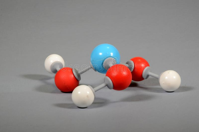 Molecule model of boric acid. White is hydrogen, light blue is boronr, red is oxygen royalty free stock image